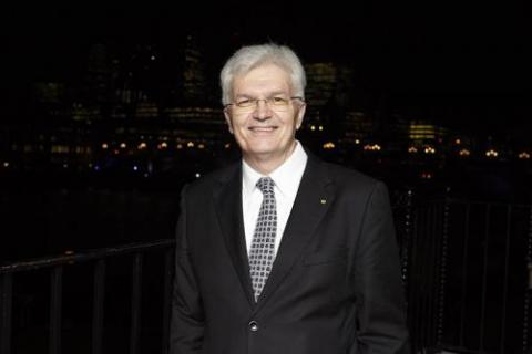 Image of Glyn Davis with a night time city backdrop